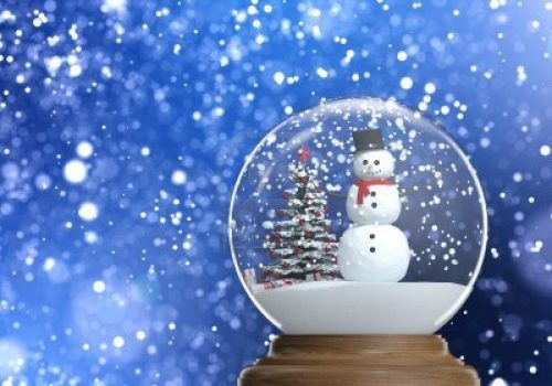 15558250-snowglobe-with-snowman-and-christmas-tree-inside-on-a-blue-snowy-defocused-background-copy-space